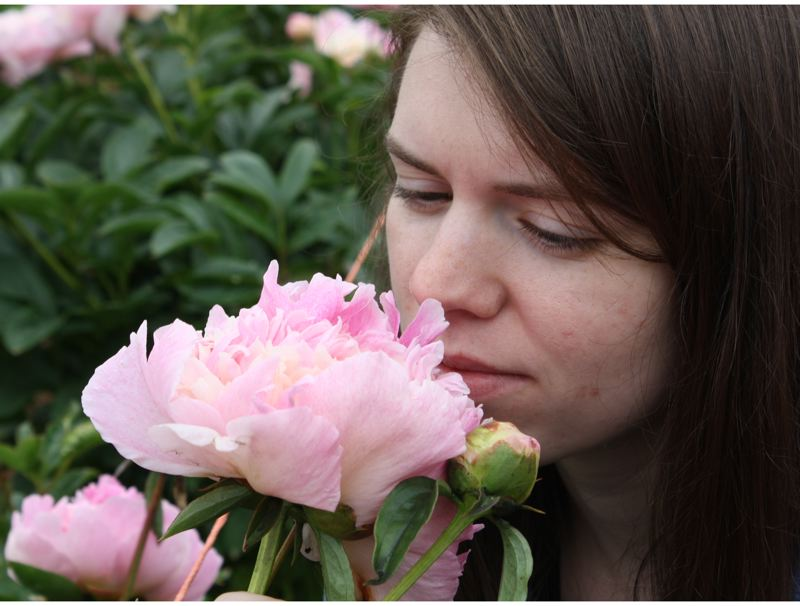 by: POST PHOTO: JIM HART - Chloe Martin finds this flower particularly fragrant and beautiful.