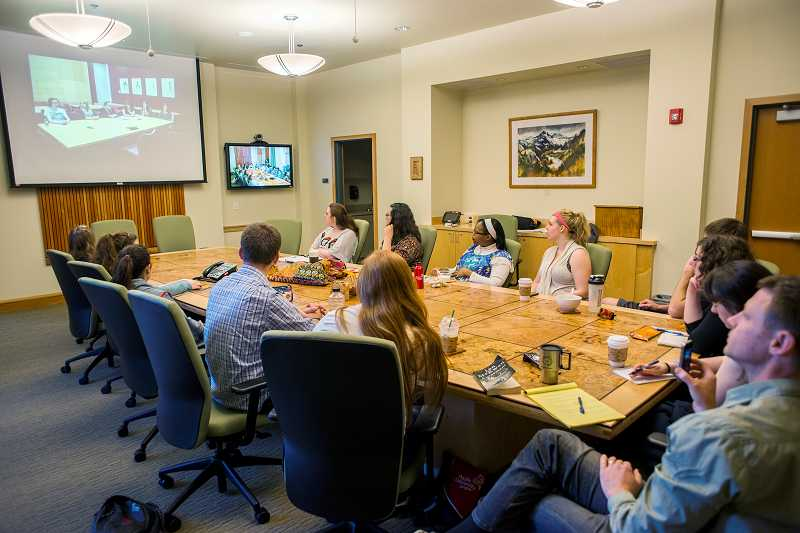 by: NEWS-TIMES PHOTO: CHASE ALLGOOD - Students in Brent Johnsons literature class at Pacific University had a chance to sit in on live web chats with pupils in England spring semester.