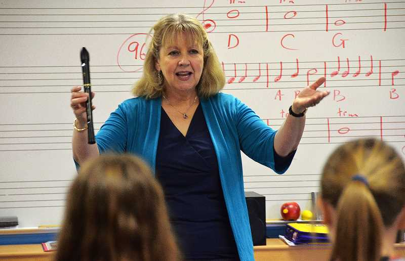 by: VERN UYETAKE - Donna Kagan holds one of her favorite instruments, a recorder, during a music class at Stafford.