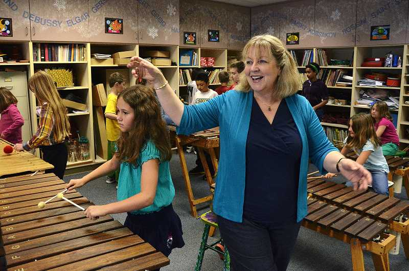 by: VERN UYETAKE - Donna Kagan starts teaching students to play marimba as early as their kindergarten year.