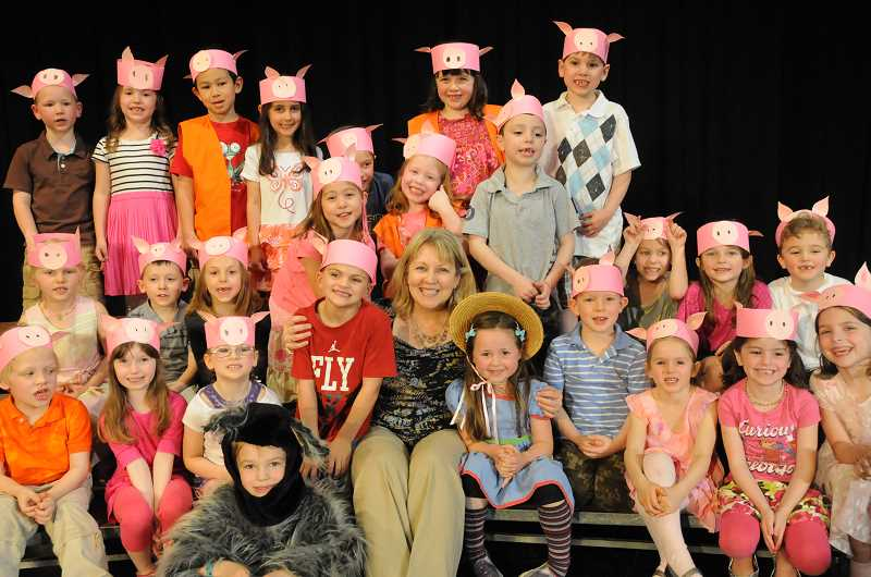 by: SUBMITTED - Donna Kagan poses with students from Kristy Claypooles kindergarten after their performance of The Three Piggy Opera on April 26.