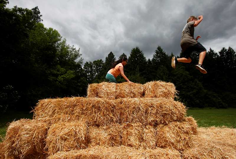 by: TIMES PHOTO: JONATHAN HOUSE - A student jumps off hay bales during the Fowler Middle School Falcon Dash. The fundraiser is one of a handful of events the schools PSO provides every year. Students received pledges from friends and family to participate in the event.
