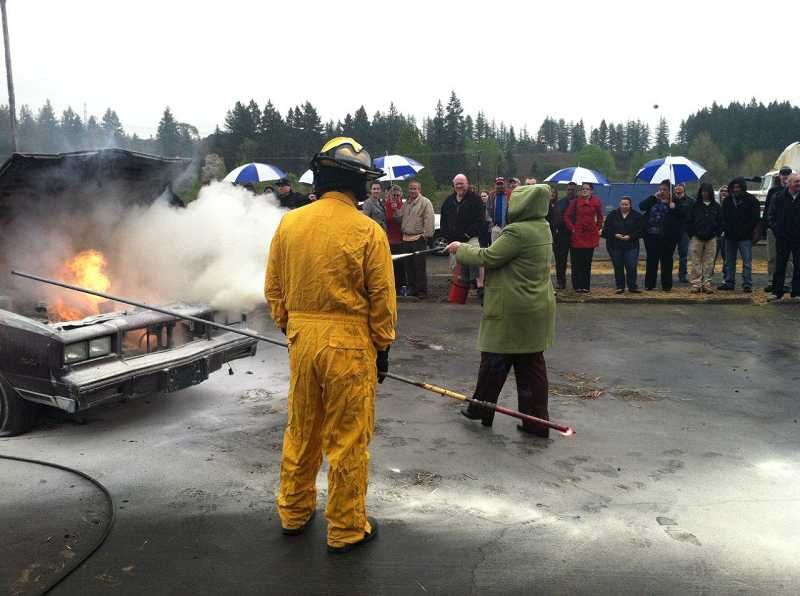 by: SUBMITTED PHOTO: TVF&R - Program participants get a chance to use a fire extinguisher on a real fire during the full-day training.