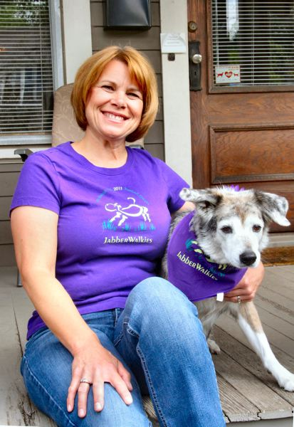 by: JUDY NELSON - Renee Stilson, the organizer and head of the JabberWalkies team from Sellwood that for the second consecutive year was the fund-raising leader in the OHS benefit Doggie Dash in downtown Portland, is shown with her dog, Kassie.