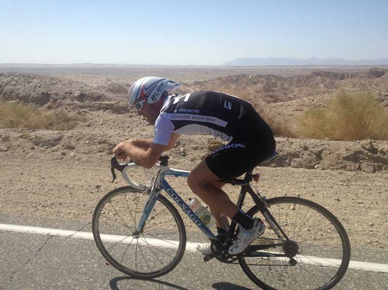 by: SUBMITTED PHOTO - Jonathan Puskas rides his bike on April 11 at a RAAM Challenge event in Southern California, where his team rode 400 miles around the Salton Sea.