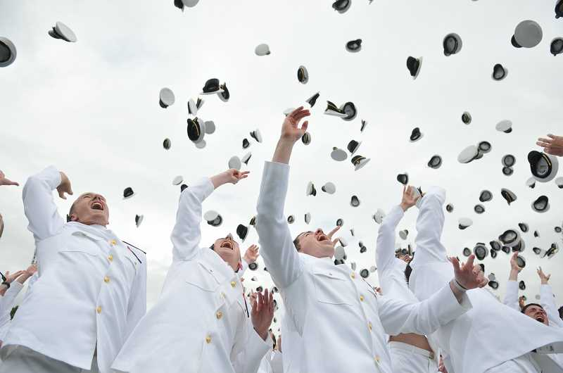 by: SUBMITTED PHOTO: U.S. NAVAL ACADEMY - Robert Bruss, left, and next to him, Brendan Hanlon, and classmates, celebrate their graduation.