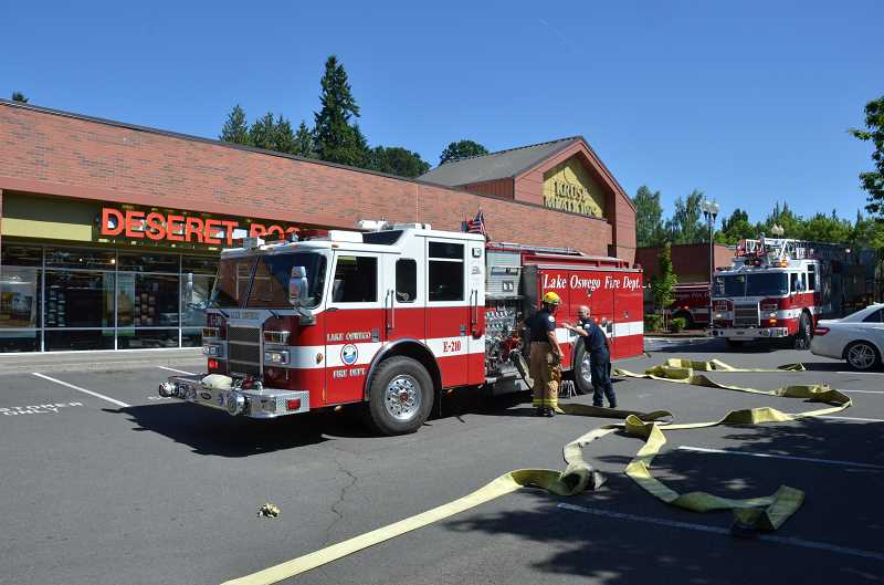 by: SUBMITTED PHOTO: GERT ZOUTENDIJK - Lake Oswego firefighters arrived in time to stop a fire from spreading throughout the strip mall on Bangy Road.
