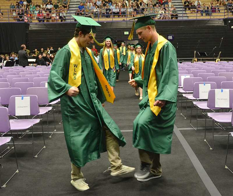 by: VERN UYETAKE - Jack McMenomey, left, and Austin Bridgeman add a little flair as they enter the auditorium.
