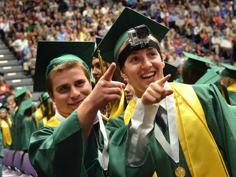 by: VERN UYETAKE - Alec Gans, left, and Zach Nelson look for friends and family as they wait for the ceremony to begin.