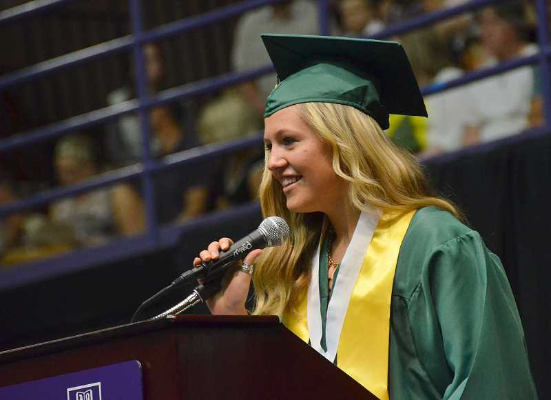 by: VERN UYETAKE - Student body president Paige Myers welcomes guests and offers introductory remarks.