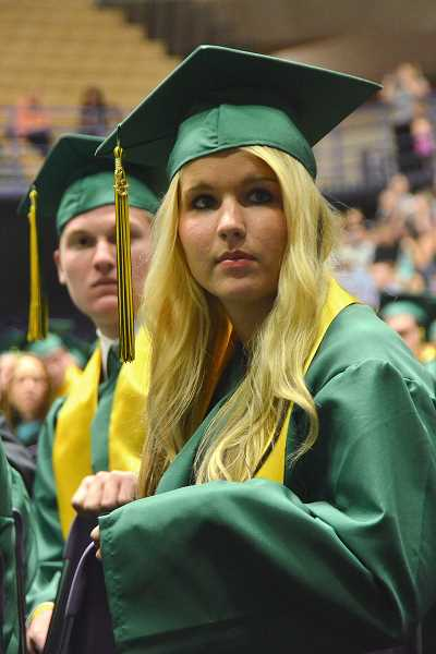 by: VERN UYETAKE - Joanie Kernagis listens to the symphonic choir performance.