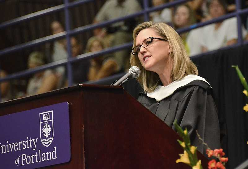 by: VERN UYETAKE - This year's distinguished teacher, Marlo McKennon, addresses the class.