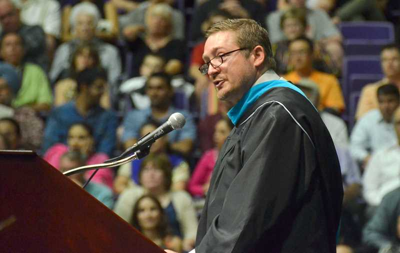 by: VERN UYETAKE - Principal Lou Bailey makes his presentation to the senior class.