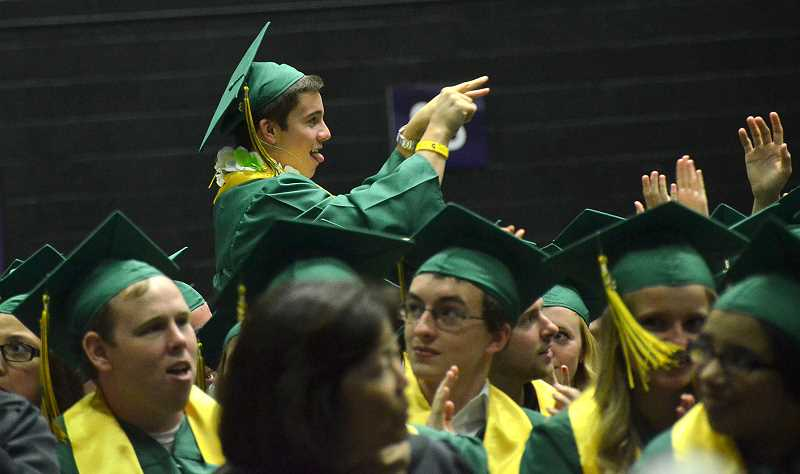 by: VERN UYETAKE - Connor Newromes points to his parents as the class offers a round of applause in recognition of all the parents.
