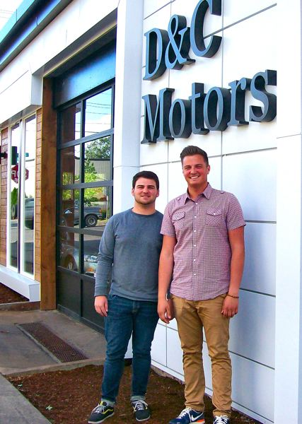 by: RITA A. LEONARD - D & C Motors recently opened a new showroom for pre-owned European cars on Holgate Boulevard at SE 27th. At left is Sales Manager Sam Cercea; owner Daniel Crainic is at right.