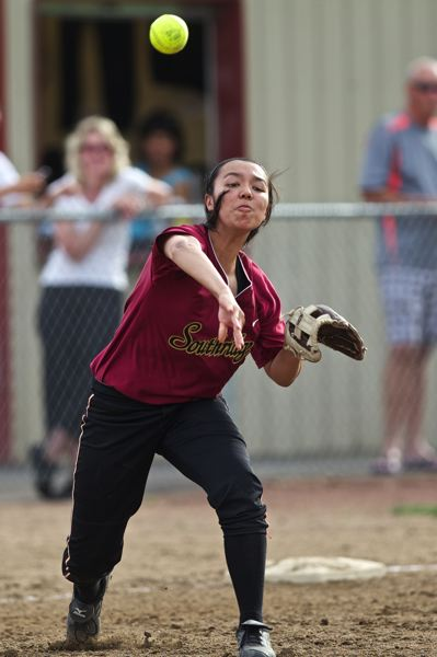 by: TIMES PHOTO: JAIME VALDEZ - Southridge Skyhawks third baseman Mahaila Nieslanik throws to first base against the Aloha Warriors.