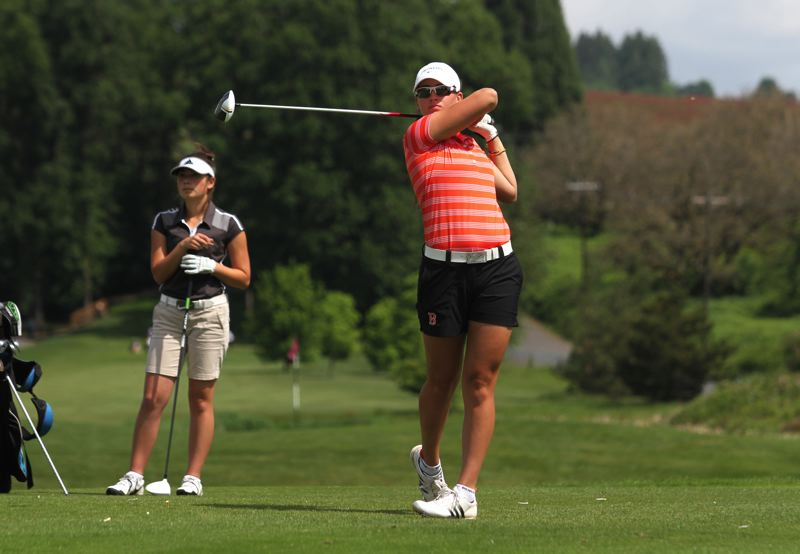 by: TIMES PHOTO: JONATHAN HOUSE - Beaverton's Gigi Stoll has gained national recognition both for her powerful drives and cool demeanor on the golf course. Stoll is a surefire high-major collegiate prospect.