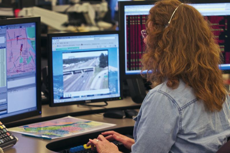 by: TRIBUNE PHOTO: JAIME VALDEZ - Jacquie Carson, emergency communication supervisor for the city of Portland, answers emergency calls at  the 9-1-1 dispatch center.