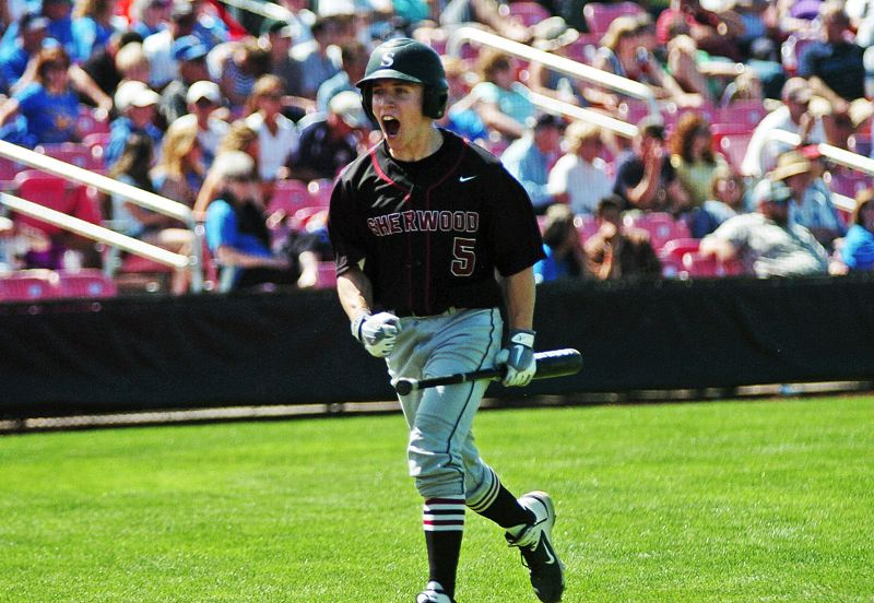 by: DAN BROOD - LET'S GO -- Sherwood High School senior Logan Ballarche' lets out a yell after he scored in the sixth inning of Saturday's Class 5A state championship game. Ballarche' scored a pair of runs in the victory.
