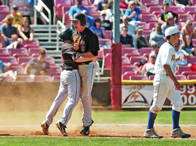 by: DAN BROOD - YEAH -- Sherwood senior Logan Dix (left) and Zak Taylor celebrate after they both scored on a two-run single by Alex Barzee in Saturday's state championship game.