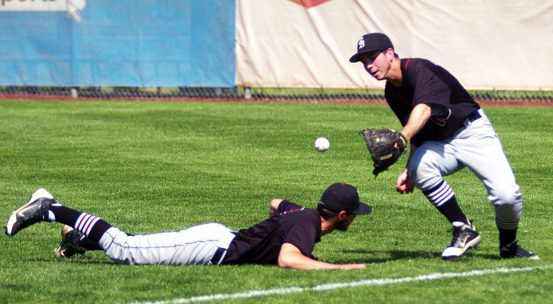 by: DAN BROOD - HUSTLING -- Sherwood senior second baseman Colton Waker (left) and senior right fielder Anthony Sherwood converge on the ball during the Class 5A state championship contest.