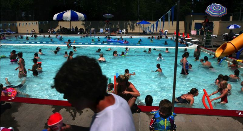 by: TRIBUNE FILE PHOTO - Summer's nearly here, so Portland Parks & Recreation plan to open its outdoor pools this month so people can beat the heat . . . when it's hot.