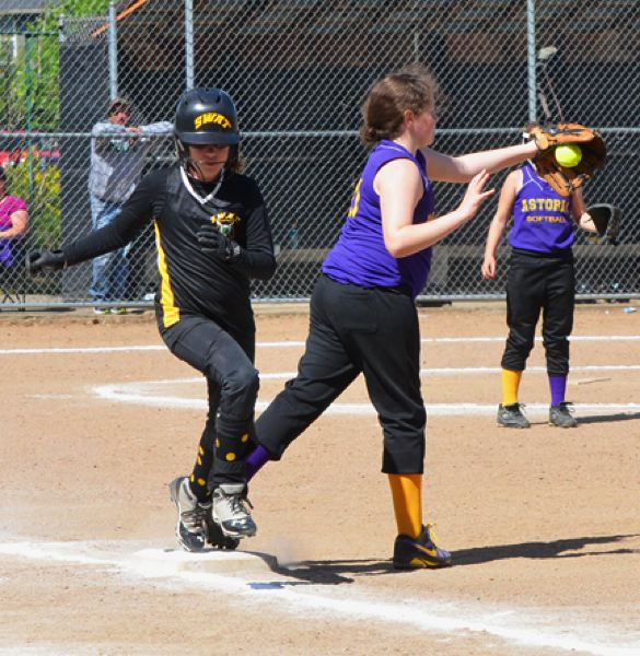 by: JOHN BREWINGTON - St. Helens' Portia White of the S.W.A.T. 10U team is barely out at first during last weekend's tournament. She would triple in her next at bat.