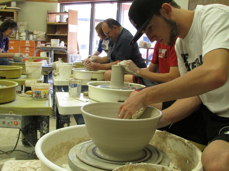by: SPOTLIGHT PHOTO: ROBIN JOHNSON - Cody Galvin, SHHS Senior, recently joined the Oregon Potters Association and will be assisting SHHS ceramics instructor Pat Brame at the Empty Bowls event during the Waterfornt Blues Festival in Portland.