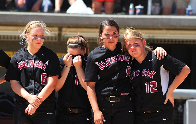 by: HILLSBORO TRIBUNE PHOTO: AMANDA MILES - Glencoe softball players Maria Dendinger (6), Kylie Surratt (14), Morgan Brown (9) and Emilee Eastman (12) react after losing 2-1 in eight innings Saturday against North Medford in the finals of the Class 6A state playoffs.