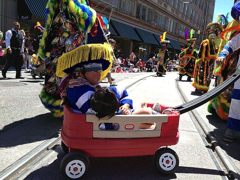 by: COURTESY OF ANDREW AEBI - A parade participant got a ride on the 4.2-mile Grand Floral Parade route Saturday morning in this photo by Andrew Aebi at Southwest 10th Avenue and Stark Street.
