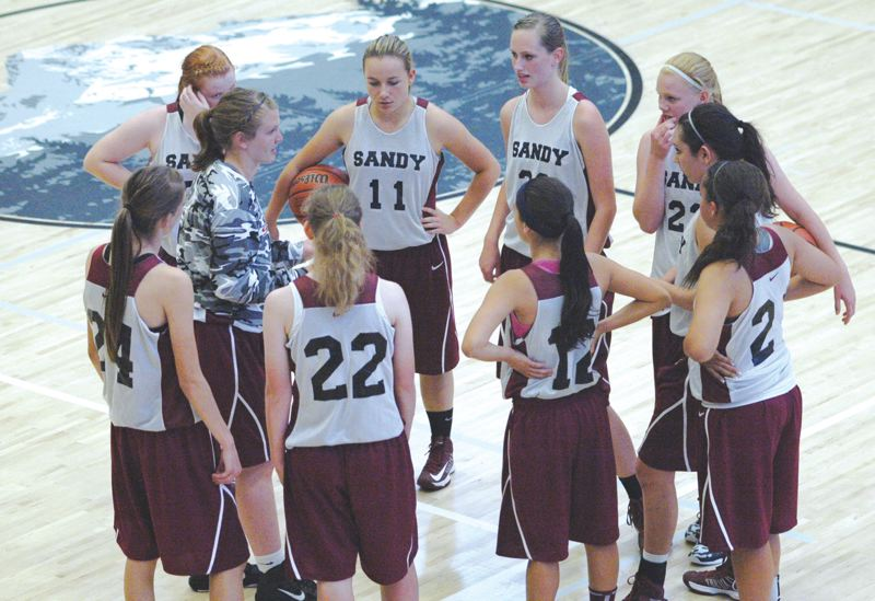 by: SANDY POST: PARKER LEE - Sandys Raquel Pellecer, in the camoflouge warmup, gathers her team during a timeout.