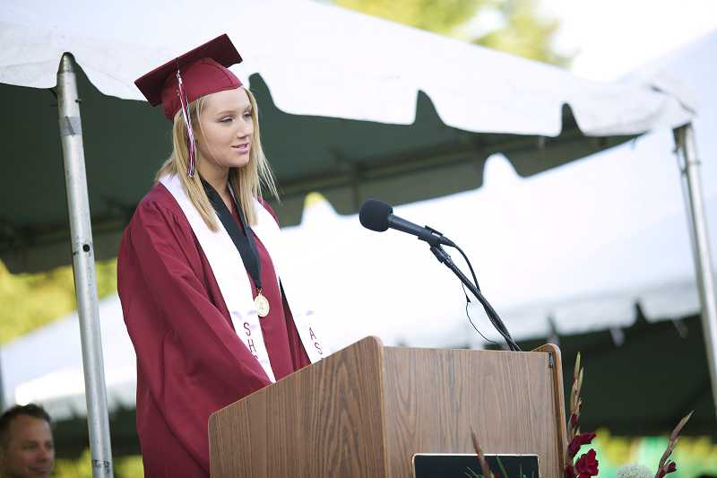 by: JAIME VALDEZ - Lauren Horner delivers the Valedictorian Address during Sherwood High School's graduation at Aaron J. Contreras Memorial Stadium.
