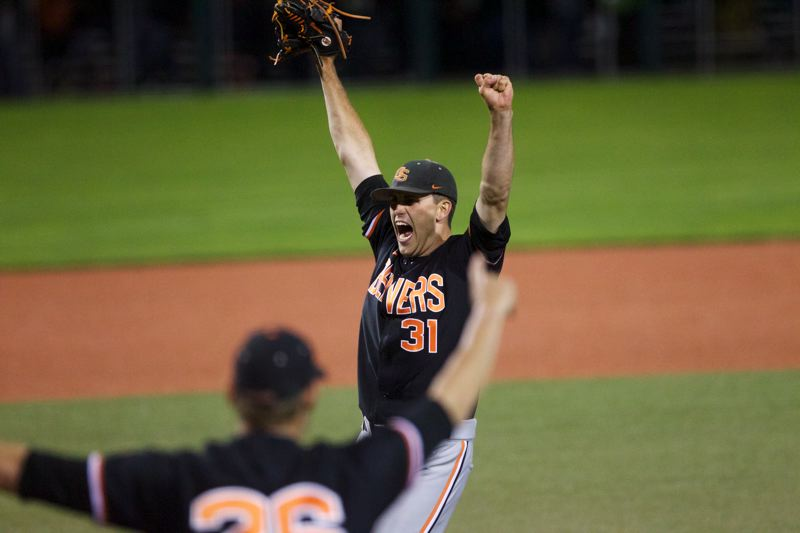 by: TRIBUNE PHOTO: JAIME VALDEZ - Starter-turned-closer Matt Boyd signals victory as he and the Oregon State Beavers turn away Kansas State's final threat in the bottom of the ninth inning at Goss Stadium.