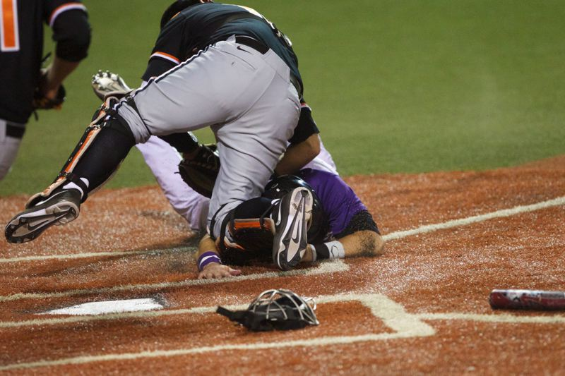 by: TRIBUNE PHOTO: JAIME VALDEZ - Catcher Jake Rodriguez makes sure of his eighth-inning tag on Kansas State's Blair DeBord, preserving Oregon State's 4-3 lead, after the throw from left fielder Michael Conforto.