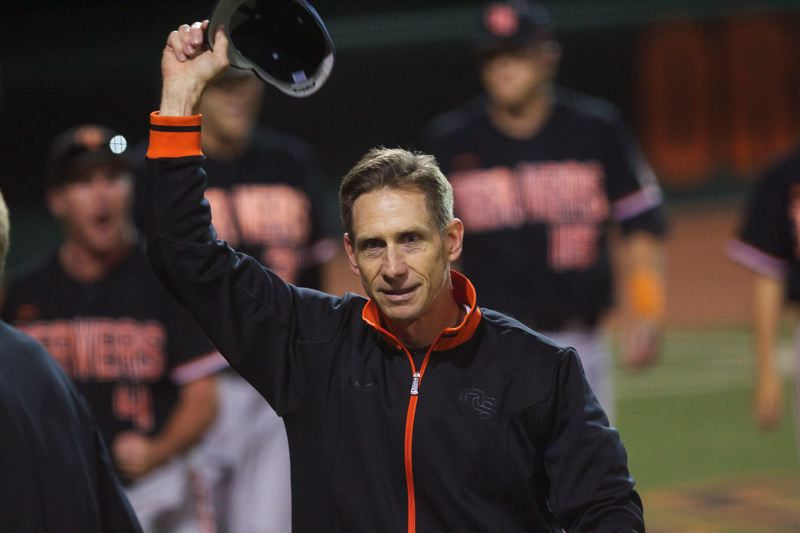 by: TRIBUNE PHOTO: JAIME VALDEZ - Oregon State coach Pat Casey waves to the crowd at Goss Stadium after the Beavers won their second game in two days to oust Kansas State in the NCAA super regional.