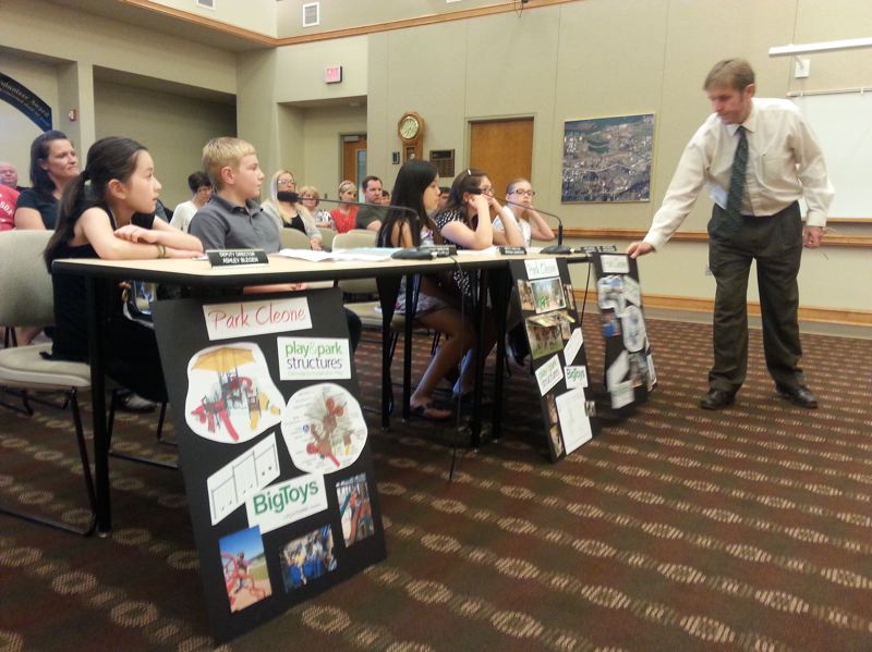 by: OUTLOOK PHOTO: CARI HACHMANN - With the help of Fairview Public Works Director Allan Berry, five elementary school students share ideas for a new playground at Park Cleone during a city council meeting.