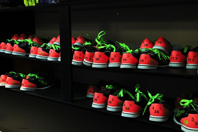 by: OUTLOOK PHOTO: ANNE ENDICOTT - Bowling shoes, and their laces, glow in the dark when worn for Cosmic Bowling.