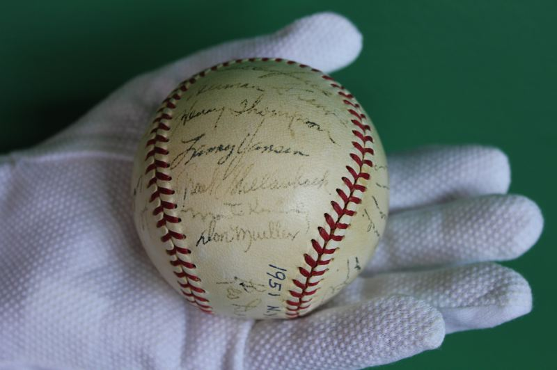 by: NEWS-TIMES PHOTO: CINDY DAUER - This signed baseball from the 1951 New York Giants team includes the signature of Verboort protege Larry Jansen. Jansen pitched for the Giants, who went 96-58 that year (wins-losses) and played in the World Series, which they lost to the New York Yankees in six games.