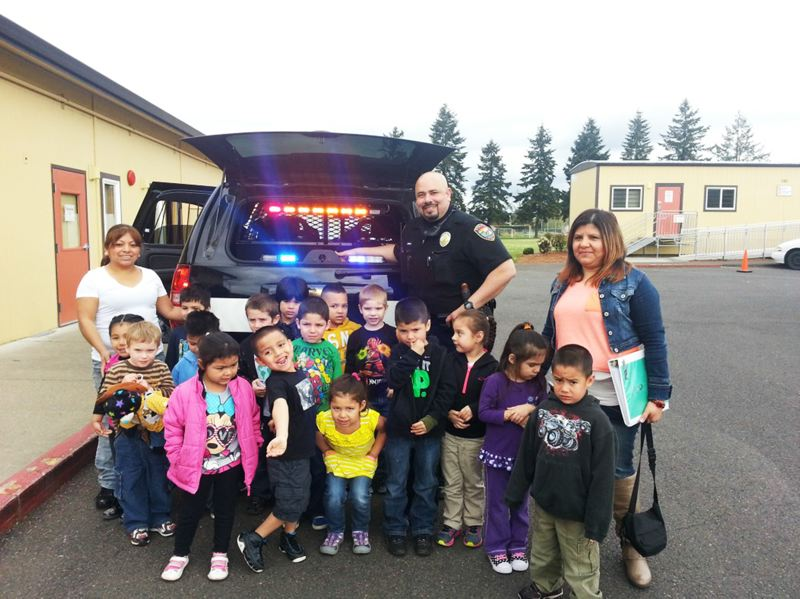 by: COURTESY PHOTO: CORNELIUS POLICE DEPARTMENT - Bilingual Officer Miguel Monico visits the Linden Street Migrant Head Start in Cornelius for a Meet Your Policeman session, where he talked about the importance of staying away from drugs and following rules.
