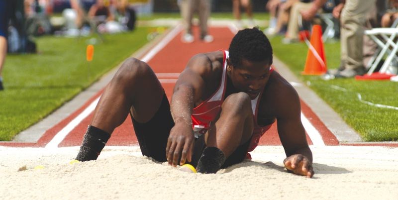 by: THE OUTLOOK: DAVID BALL - David Douglas senior Ihoghama Odighizuwa lands in the sand during his runner-up finish in the triple jump at the 6A state track meet two weeks ago. He helped the Scots to a third-place team finish at the meet.