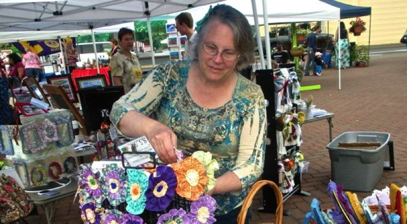 by: POST PHOTO: JIM HART - Cindy Swanson, owner of Useful Gifts of Clackamas, is becoming a regular vendor at Sandys Saturday Market, with her handmade items that have the purpose of making life easier or more pleasant. Swanson said she would be at the June 15 market in Centennial Plaza.