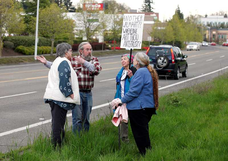 by: TIMES PHOTO: JONATHAN HOUSE - Opponents have been fighting to keep a proposed Walmart store off Southwest Dartmouth Street near 72nd Avenue for months. On Tuesday the Tigard City Council said it would look into some regulations for big box stores, though not enough to stop the retail giant from coming.