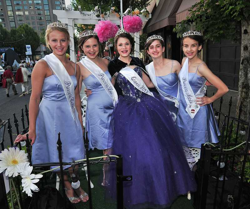 by: TIDINGS PHOTO: VERN UYETAKE - West Linn Old Time Fair princesses and queen rode a float during the Portland Starlight Parade on June 1. Pictured, from left, are Princess Cella Lawrence, Princess Zoe Craig, Queen Bobbie OBrien, Princess Beth Hoots and Princess Natalie Bruun.