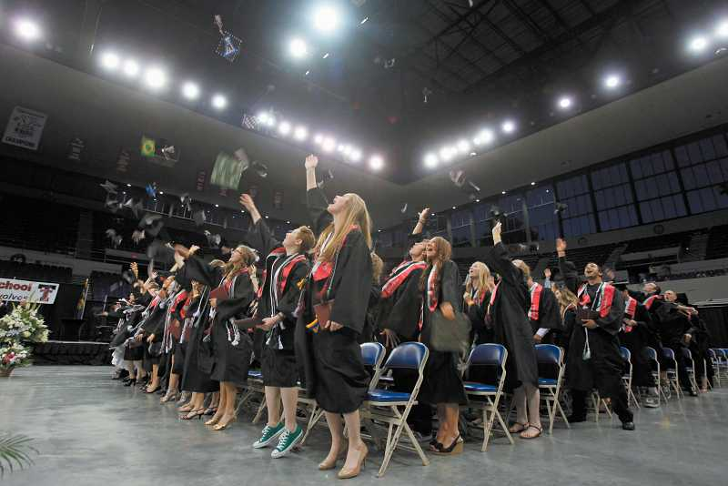 by: TIMES PHOTO: JONATHAN HOUSE - Tualatin High School graduates celebrate at Memorial Coliseum.