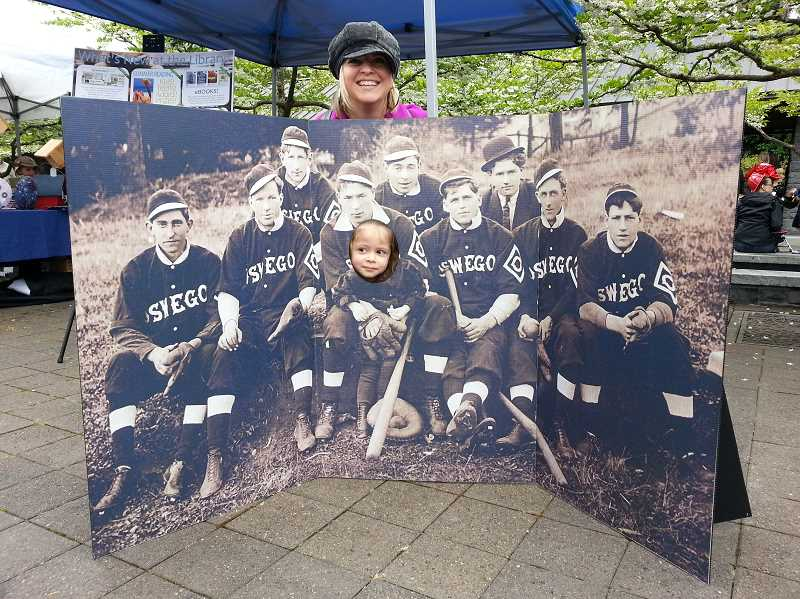 by: JANE CARR - Courtney Gomez got a big kick out of her daughter, Gemma, putting her face in the photo featuring Happy Johnson, her great-great-grandfather.