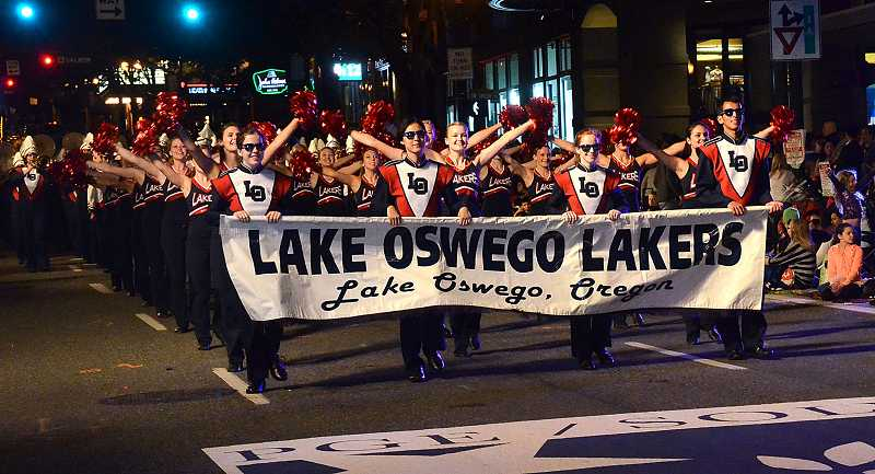 by: REVIEW PHOTO: VERN UYETAKE - Lake Oswego High School band members took first place in the 100 and more category in the Starlight Parade earlier this month.