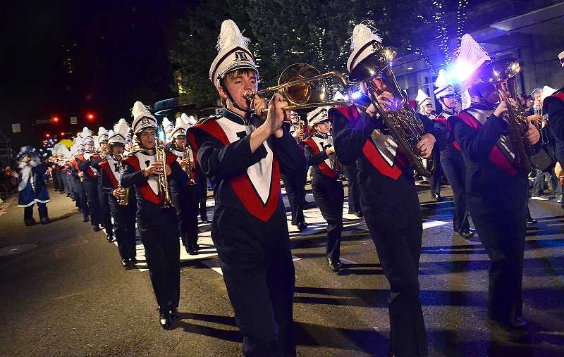 by: REVIEW PHOTO: VERN UYETAKE - Lake Oswego Highs about 170-member marching band includes violinists and violists, which is highly unusual.