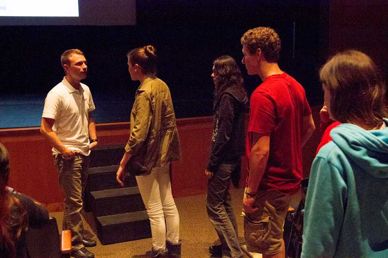 by: SUBMITTED PHOTO: NATHAN VANDERVEER-HARRIS - Lake Oswego High School students visit with Tyler Presnell after his presentation last month.