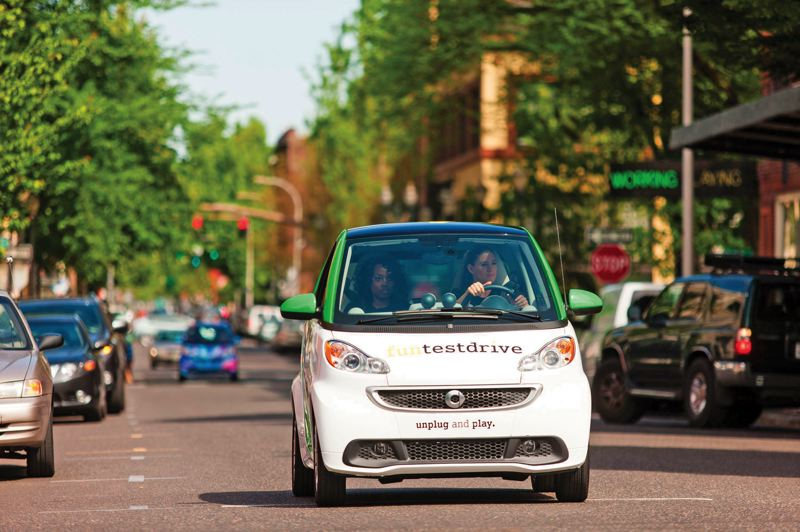 by: PAMPLIN MEDIA GROUP: CHRISTOPHER ONSTOTT - A Portland motorist test-drives a new all-electric version of Smart Fortwo, made by Mercedes-Benz. The microcars are just now arriving in Mercedes dealerships around town for sale or lease.