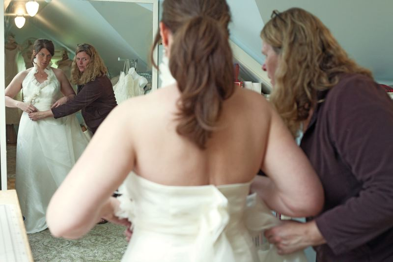 by: PAMPLIN MEDIA GROUP: JONATHAN HOUSE - Terri Spaeth-Merrick of Embellish Design helps fit a wedding dress for soon-to-be bride Beth French. Speth-Merrick uses sustainable fabrics for her dresses.